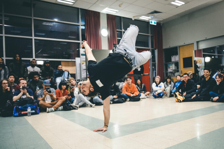 Bboy throwing down a set in a battle