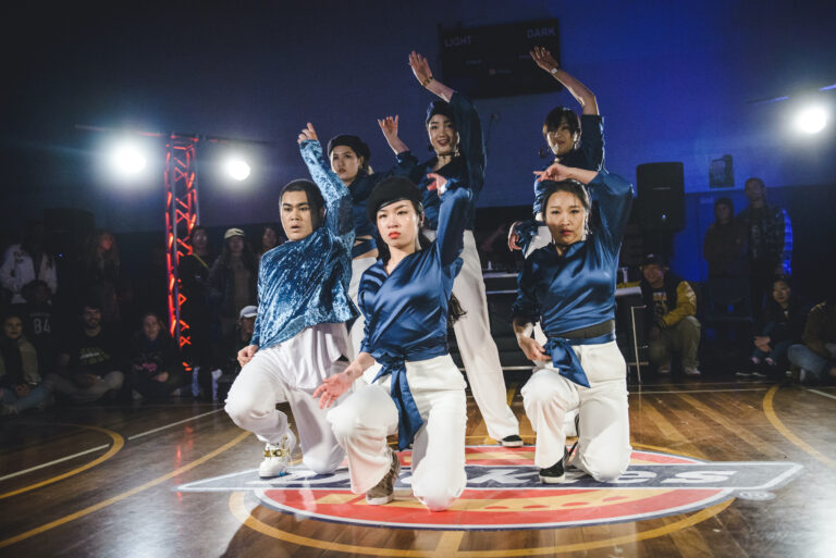 Waacking dance crew performing